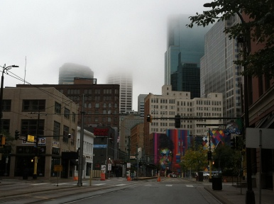 The fog slowly lifts over downtown Minneapolis on Saturday morning.