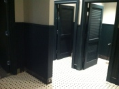 What I can only assume will be the Men's Room once they install the urinals. The tile floor and dark green stall doors (nice touch) reminds me a lot of New Haven Pizza places from growing up.